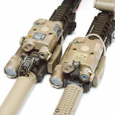 Two rifles with laser modules, and metal front sights attached to the forend of the rifle. Tactical Equipment, Tactical Gear, Tactical Knife, Survival Equipment, Survival Tools, Weapons Guns, Guns And Ammo, Rifle Accessories, Iron Sights