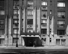 """The entrance to 55 Central Park West. This building, designed by Schwartz & Gross, was constructed in 1929. Unlike its mainly monochrome neighbors, this Art Deco style building is a gradient with red bricks at the base blending into yellow-white bricks at the top. Scenes from the 1984 film """"Ghostbusters"""" were filmed at 55 Central Park West, as such the building is now referred to as """"The Ghostbusters Building."""" White Bricks, Red Bricks, New York City Buildings, Gramercy Park, Upper West Side, Picture Postcards, Central Park, Art Deco Fashion"""