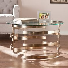 Round Reuss Art Deco Style Cocktail Table with Champagne Colored Interlocking Design Base and Tempered Glass Top >>> You can find more details by visiting the image link. (This is an affiliate link and I receive a commission for the sales) Stone Coffee Table, Glass Top Coffee Table, Lift Top Coffee Table, Cool Coffee Tables, Round Coffee Table, Coffee Table With Storage, Modern Coffee Tables, Coffee Table Wayfair, Contemporary Coffee Table