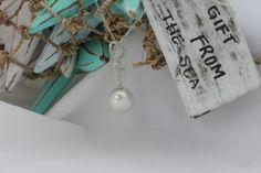 60% 0ff 18ct white gold pendant featuring a South Sea button pearl and diamonds set into a ribbon design.