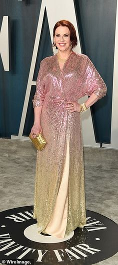Bold: Megan Mullally glimmered in an ombre dress which started with pink beading along her...