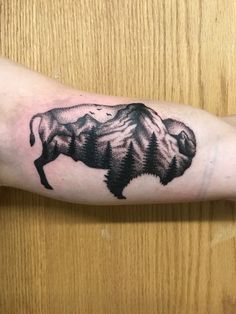Buffalo tattoo with pointillism.