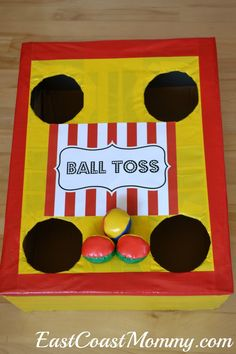 This site has a bunch of fantastic DIY carnival games and activities... including this BALL TOSS made from an old cardboard box.