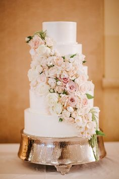 Five tier wedding cake with cascading florals: http://www.stylemepretty.com/california-weddings/goleta/2017/01/12/ballroom-wedding/ Photography: Michael and Anna Costa - http://www.michaelandannacosta.com/