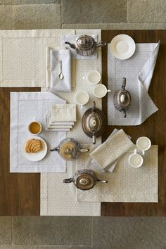 Inspired by the ornamental patterning of classic filigree jewelry, this European-woven linen creates a gracious, elegant place setting.