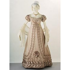 Ball gown    Place of origin:  UK (possibly, made)   France (possibly, made)    Date:  1820-1823 (made)    Artist/Maker:  unknown (production)    Materials and Techniques:  Silk satin, trimmed with silk satin and silk bobbin lace