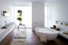 Plank flooring, matching sinks with tub, faucet that doesn't impede your bath