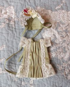 Mignonette dress in natural green silk, handmade in antique fabric and laces