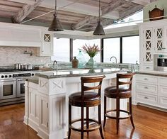 Panoramic views and exposed wood gives this kitchen a beachy feel. See the rest of it here: http://www.bhg.com/decorating/decorating-style/cottage/ocean-inspired-kitchen-makeover/?socsrc=bhgpin092712oceaninspiredmakeover