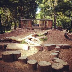 natural playscape: stumps/wood rounds, stones, large branches, ...