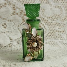 Green Perfume Bottle Embellished with Vintage Jewelry Pieces by glassbeadtreasures, via Flickr