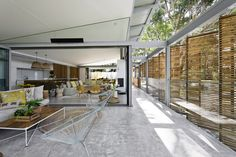 The living room of the Australian home can be almost completely opened up to the surrounding bush.