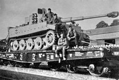 Tiger tank on rail...It is wearing it's transport tracks and its combat tracks appear to be under its hull