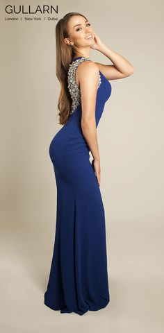 The Esque Dress. Indicates style, charm and unique character. A stunning piece encapsulating the current trend of backless beauty. The graceful neckline and large clusters of rhinestones, beads and sequins provide a touch of magic. A seductive gown which leaves much to be desired.