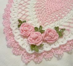 crocheted oval doily pink and white spring colors by Aeshagirl