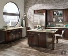 Porcelain Tile that looks like wood... perfect for the kitchen. Gorgeous!