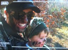 Luke bryan hunting and Luke bryan with his son..like he needs things to make him more attractive!