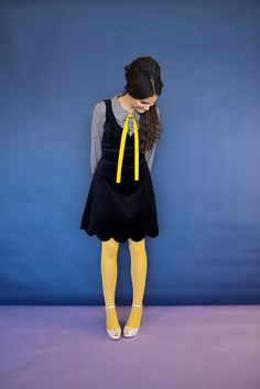 Precious 1950s school girl look with a pop of yellow.