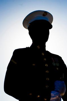 """A Marine with the Marine Corps Silent Drill Platoon stands at ceremonial at ease position during Challenge Day at Marine Corps Air Station Yuma, Ariz., Feb. 21. Every year, new SDP Marines compete for a spot on """"The Marching 24,"""" during a thorough performance evaluation known as Challenge Day. Also, Marines already in the platoon get a chance to earn a higher position within the elite marching unit through the same evaluation. SDP, part of the Battle Color Detachment, is currently in…"""