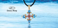 Denny Wong 18K two tone pendant with 4.96tw moonstone, 2.28tw blue topaz mounted underneath, .66tw pink sapphire, .08ct tanzanite and .02ct diamond. Pendant measures 43mmx35mm