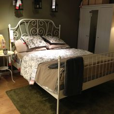 bed frame in the store - I like how a rug underneath adds texture, and warmth!