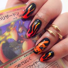 I love collaborating with my boyfriend @don_ketchum. Enjoy these Charizard nails! ❤️❤️Thanks @nailartistrylove for the inspiration to execute some badass Pokemon nail art. #pokemon #charizard #pokemonnails #charizardnails #pokemoncard #flamenails