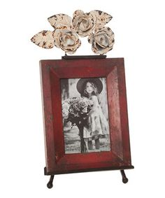 Using red as an accent color is an enticing and intriguing decorating tip that draws attention to otherwise unnoticeable items in a room. This ruby frame is the perfect less-is-more approach to showing off a favorite photo.