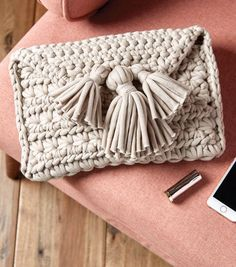 JOANN Crochet Projects: Featuring easy and advanced crochet projects for kids and adults. Browse JOANN craft ideas and projects online. Crochet Clutch Pattern, Clutch Bag Pattern, Crochet Clutch Bags, Crochet Wallet, Diy Clutch, Crochet Handbags, Crochet Purses, Crochet Patterns, Crochet Bags
