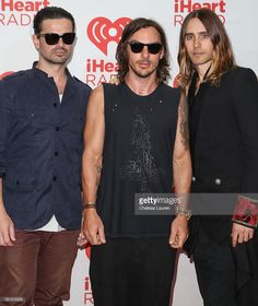 Guitarist Tomo Milicevic, drummer Shannon Leto and vocalist Jared Leto of 30 Seconds to Mars pose in the iHeartRadio music festival…