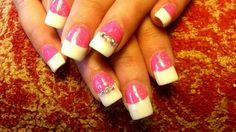 White acrylic nail tips with hot pink glitter nail beds and Swarovski crystals