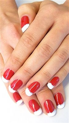 Step 1: Paint your nails a bright red shade  and let it dry completely.Step 2: Paint the tips of each nail white .Step 3: Add a thin silver line between the red and white sections