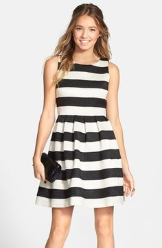 Free shipping and returns on Soprano Banded Skater Dress (Juniors) at Nordstrom.com. Glam black-and-white stripes textured with scalloped stitches layer atop one another to fashion the pleat-flared skirt of this sleeveless skater dress.