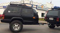 When life gives you lemons, make lemonade. When it gives you a damaged Jeep Cherokee, make a badass trailer.