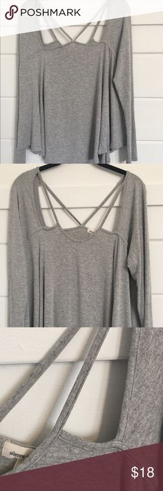 UO Silence + Noise top This is an ADORABLE long sleeve top with cutouts on front and back. Size medium and runs big. Sleeves are fitted while the body is flowy. Looks great with a lace bralette! Very good quality material, solid but lightweight enough to wear and layer all year round. Only worn twice. silence + noise Tops Tees - Long Sleeve