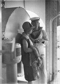 "Sailor of HMAS ""Australia"" fondles woman's string of pearls, c. 1929 / by Sam Hood"