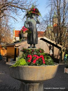 Statue of Liesl Karlstadt in the Viktualienmarkt in Munich.  I love how they dress her up according to the season! :)