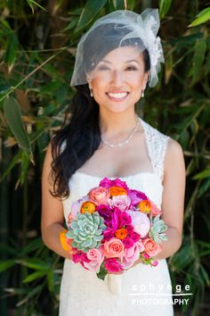 bride with monique lhuillier lace wedding dress, bird cage veil and succulent, peonie and rose bouquet