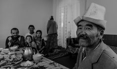 A scene from Kyrgyzstan. Kyrgyz family on breakfast.