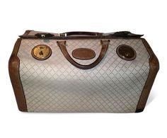Vintage 1950s Gucci overnight/vanity bag. Online Auction starting at only $360! Bid now at AuctionMyStuff.com