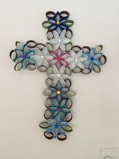 Cross of flowers made from toilet paper rolls. Lots of fun to make.