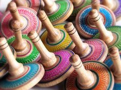 Colored spinning tops Spinning Top, Woodturning, Handmade Wooden, Games, Color, Woodwind Instrument, Top, Plays, Colour
