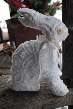 Primitive Chenille White Easter Spring Bunny Rabbit Pillow. $11.95, via Etsy. I would have to coffee stain him right up.
