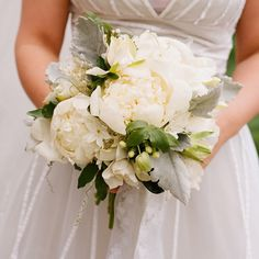 """...Bouquet included peonies, paperwhites, gardenias, lily-of-the-valley, dusty miller, passion vine, and stephanotis vine, and was all tied up with two types of beautiful silver ribbon from Britex."""