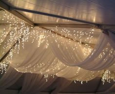 Drapes and Fairy Lights. If we had the formal in the ballroom we could do something like this with clear cellophane and lights... From the ceiling