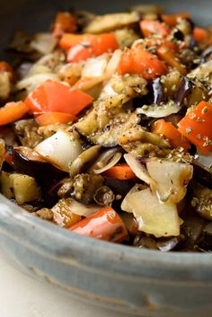 The happy mix of eggplant, peppers and onions is found throughout the Mediterranean Cooking the vegetables over hot coals adds a welcome smokiness, but even a stovetop grill gives a hint of smoky flavor, so don't fret if you can't grill outside This salad is meant to be served at room temperature