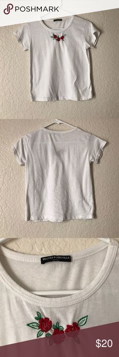 Brandy Melville top  Embroidered rose crop top. Good condition!  some light pilling but that's normal with this brand! Brandy Melville Tops Crop Tops