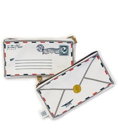 This little airmail envelope is the perfect place for your trinkets or makeup in your purse, or kids pencils and pens in their backpacks. Made in the USA of cotton, with the cutest little brass postag