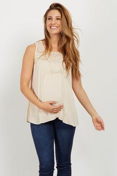 This cute maternity top is the perfect piece for this season. A pretty crochet neckline and and a comfortable material, this chic top will be your new favorite. Style this top with your favorite maternity jeans and wedges for a complete look.
