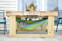 Child sized hammock under a pallet table diy project