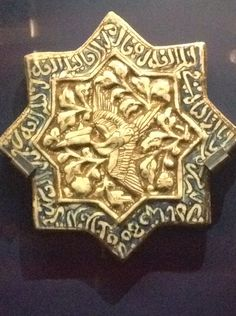 Location Victoria Albert museum London  Tile with phoenix and Qur'anic text  Iran 1275-1325
